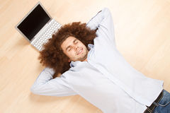 Man Relaxing with Laptop Stock Image