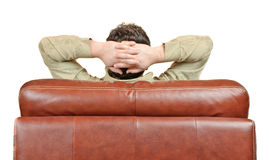 Man relaxing in leather armchair back view Royalty Free Stock Image