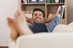 Man relaxing in living room Stock Image