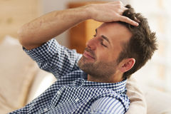 Man relaxing in living room Royalty Free Stock Photo