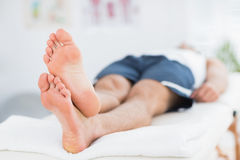 Man relaxing on massage table Royalty Free Stock Photos