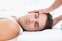 Man relaxing on massage table Royalty Free Stock Images