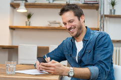 Man relaxing with mobile phone Royalty Free Stock Photo