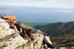 Man relaxing at mountain top Stock Photography