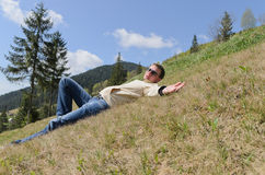 Man relaxing in the mountains Royalty Free Stock Images