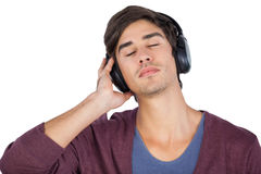 Man relaxing with music. On his headphones Stock Images