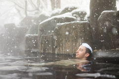 Man relaxing in Japanese onsen Royalty Free Stock Photos