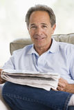 Man relaxing with a newspaper Royalty Free Stock Photo