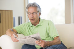 Man relaxing with a newspaper stock photos