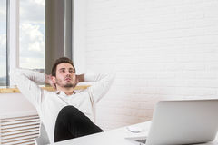 Man relaxing in office Royalty Free Stock Photo