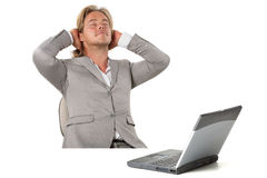 Man relaxing at the office Stock Images