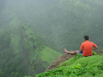 Man Relaxing On Mountainside Royalty Free Stock Images