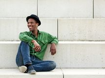 Man relaxing outdoors with music Royalty Free Stock Images