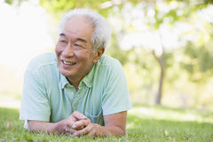 Man relaxing outdoors smiling Royalty Free Stock Photography