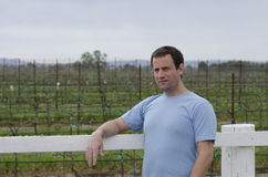 Man relaxing outside in a vineyard. Hopeful for tomorrow. Stock Image