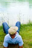 Man Relaxing At Pond Stock Photos