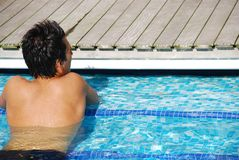 Man relaxing at the pool Royalty Free Stock Images