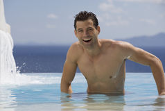A man relaxing in a pool Royalty Free Stock Photography