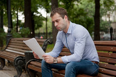 Man relaxing in the public garden Stock Photography