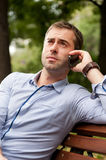 Man relaxing in the public garden Stock Image
