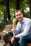 Man relaxing in the public garden Stock Photos