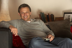 Man Relaxing With Remote Control Royalty Free Stock Photo