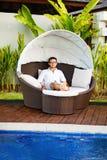 Man relaxing at resort Stock Image