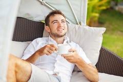 Man relaxing at resort Stock Photography