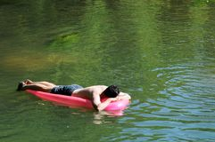 Man relaxing on river Stock Photo