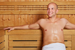 Man relaxing in a sauna Royalty Free Stock Image