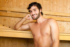 Man relaxing in a sauna Royalty Free Stock Photo