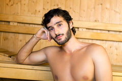 Man relaxing in a sauna Royalty Free Stock Photos