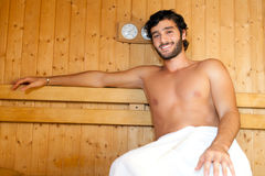 Man relaxing in a sauna Stock Image