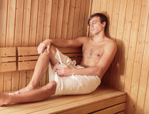 Man relaxing in the sauna Stock Images