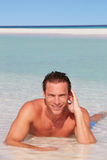 Man Relaxing In Sea On Beach Tropical Beach Stock Photos