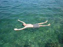 Man relaxing in the sea Royalty Free Stock Photos