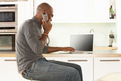 Man Relaxing Sitting In Kitchen Talking On Phone Stock Photos