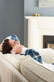 Man Relaxing Sitting On Sofa At Home On Phone Royalty Free Stock Photography