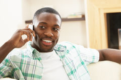 Man Relaxing Sitting On Sofa Talking On Phone Stock Photo
