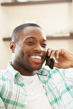 Man Relaxing Sitting On Sofa Talking On Phone Royalty Free Stock Image