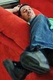 Man relaxing on sofa Stock Photography