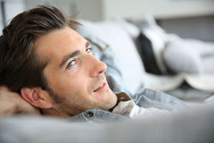 Man relaxing in sofa Royalty Free Stock Image