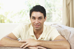 Man Relaxing On Sofa At Home Stock Photography