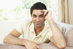 Man Relaxing On Sofa At Home Royalty Free Stock Photo