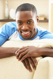 Man Relaxing On Sofa At Home Royalty Free Stock Images