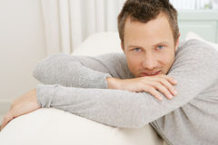 Man relaxing on sofa at home. Royalty Free Stock Photography