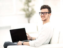 Man Relaxing on Sofa with Laptop Computer Royalty Free Stock Image