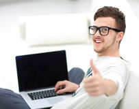 Man Relaxing on Sofa with Laptop Computer Royalty Free Stock Photos