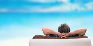 Man relaxing on a sofa . Stock Photo