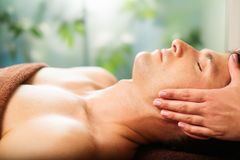 Man relaxing in spa salon royalty free stock photo